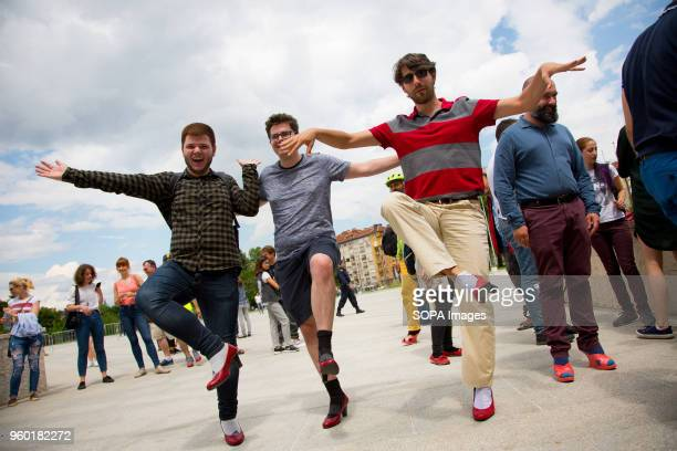 Men pose wearing highheeled shoes in order to show solidarity with women and the struggles they face during the 'Walk a Mile in Her Shoes' campaign...