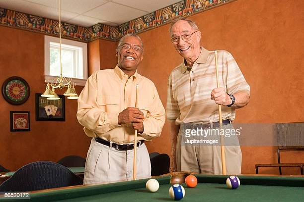 men posing next to pool table - old men playing pool stock pictures, royalty-free photos & images
