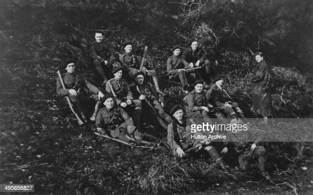 Men, possibly of the Royal Irish Constabulary resting in the hills of Tipperary, Ireland, during the Irish War of Independence, 1921. From the A. E....