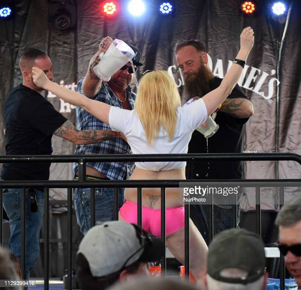 Men pour ice water on a contestant in a wet tshirt contest on March 8 the opening day of Bike Week in Daytona Beach Florida The 10day event which...