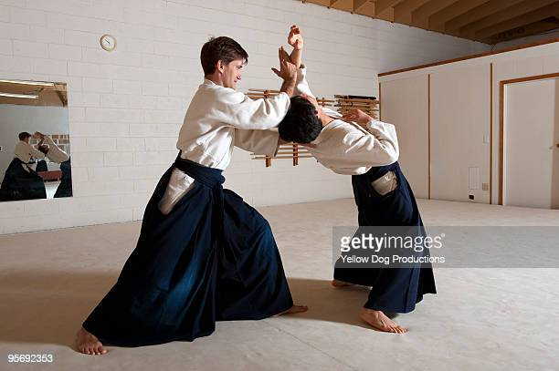 Men practicing aikido martial arts