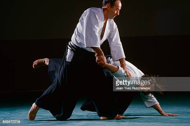 Men Practicing Aikido