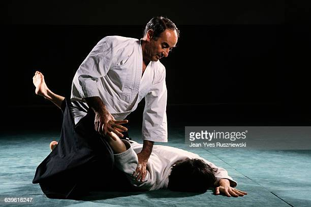 Men practicing the Japanese martial art of Aikido