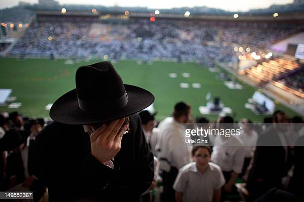 Men pray as tens of thousands of Ultra Orthodox Jews attend Siyum HaShas a celebration marking completion of a sevenand a half year daily studycycle...