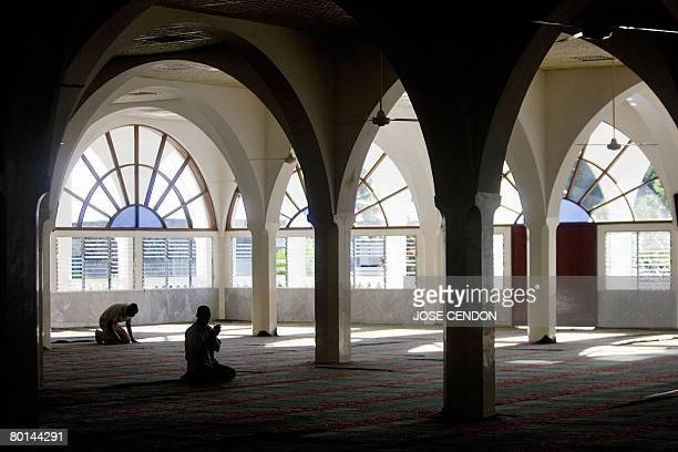 Men pray at a Mosque on March 5 2008 in Moroni the capital of the Union of Comoros African Union envoy to the Comoros Mourad Taiati said several...