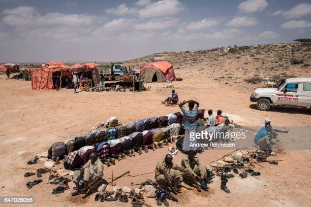 Men pray at an IDP camp on February 24 2017 in Karin Sarmayo Somalia Brief rains brought an estimated 100000 people to the region in search of land...