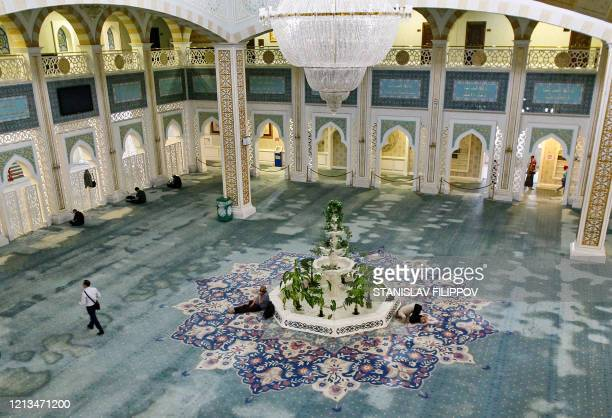 Men pray at the Hazrat Sultan Mosque in NurSultan on May 18 amid the coronavirus pandemic Residents of Kazakhstan's capital NurSultan trickled back...