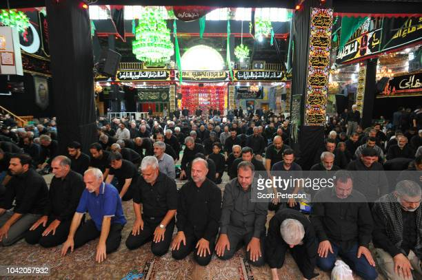 Men pray at the Karbalaei mosque as Iranians mark the anniversary of the 7th-century death of the third Shiite Imam Hossein, with day and night...