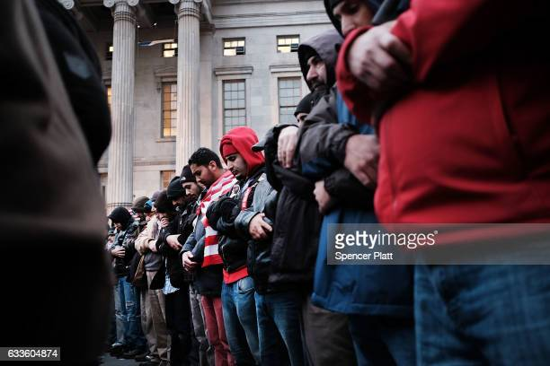 Men pray during a protest by ethinic Yemenis and supporters over President Donald Trump's executive order temporarily banning immigrants and refugees...