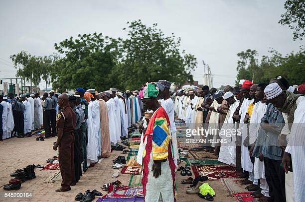 Men pray during morning prayer at the Kofar Mata Eid Ground during the Durbar Festival in Kano northern Nigeria on July 6 2016 Kano is Nigeria's...