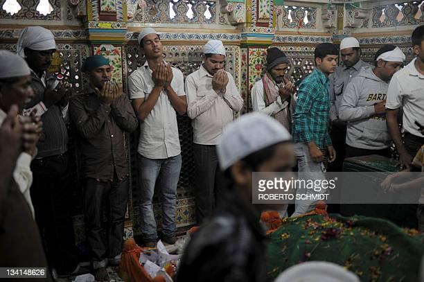 Men pray inside the Nizamuddin Dargah a mausoleum complex of one of the world's most famous sufi saints Nizamuddin Auliya in New Delhi on November 27...