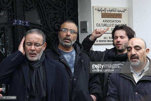Men pray on March 13, 2012 outside the Rida mosque in the Anderlecht neighborhood of Brussels, a day after an attack with a Molotov cocktail left the...