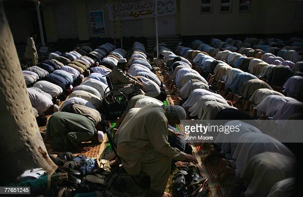 Men pray outside the Red Mosque on November 2 2007 in Islamabad Pakistan During the Friday service the mullah preached against the Pakistani...