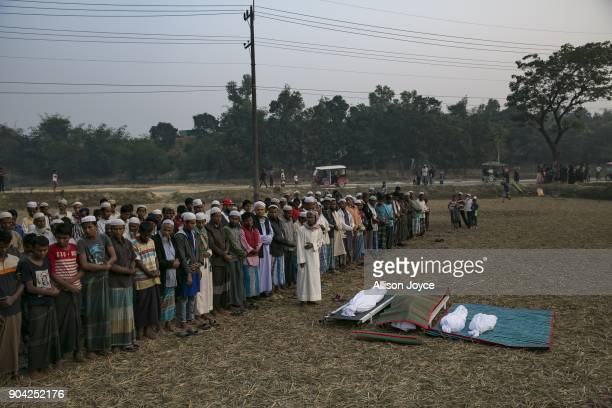 COX'S BAZAR BANGLADESH JANUARY 12 Men pray over the bodies of Rohingya refugees before their burial in Balukhali camp on January 12 2018 in Cox's...
