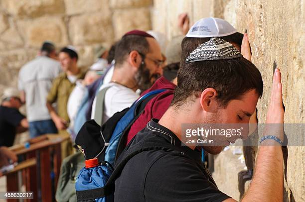 men praying at jerusalem's western wall - israeli ethnicity stock pictures, royalty-free photos & images
