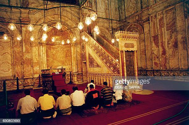 Men praying in the Mosque of Muhammad Ali Cairo Egypt