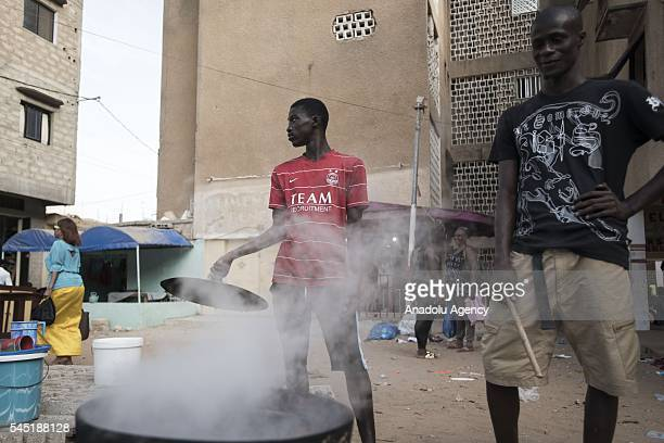 Men prepare coffee touba for the end of the Ramadan to cut the fast at HLM Market on July 05 2016 in Dakar Senegal