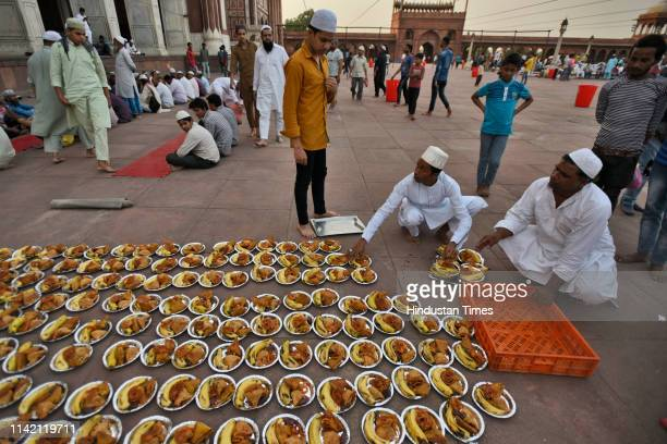 Men prepare meals to break their fast on the first day of the holy fasting month of Ramadan at Jama Masjid on May 7 2019 in New Delhi India