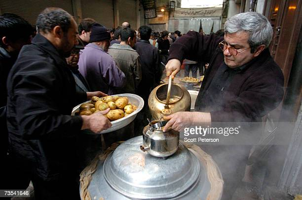 Men prepare potatoes and tea to serve the faithful as Iranian Shiite Muslims mark Arbaeen the 40th day after the death of Imam Hussein in 680 AD in...