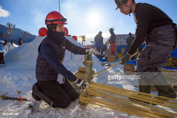 Men prepare rope for use in the construction of the shrine during preparations for the Nozawaonsen Dosojin Fire Festival on January 14 2018 in...
