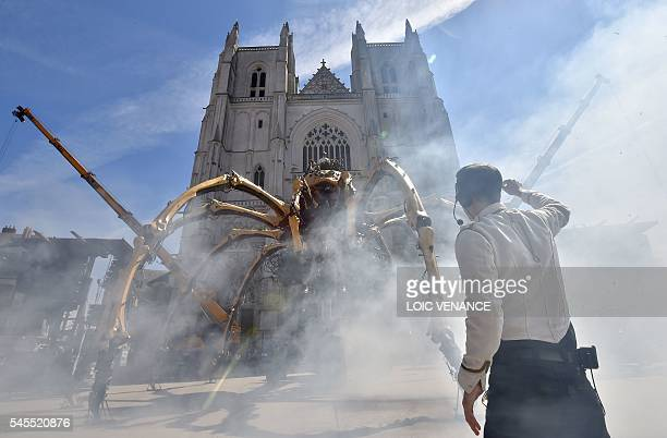 Men prepare to pilot Kumo a mechanical spider made of wood and steel by Les Machines de L'Ile factory presented to the public for the first time in...