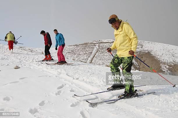 Men prepare to ski on Kabul Mountain Kabul Afghanistan on January 19 2017
