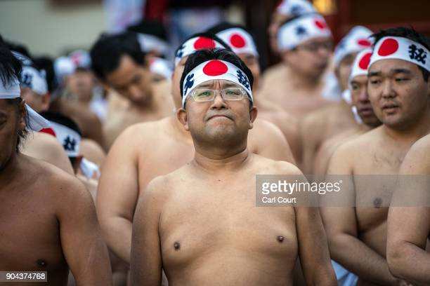 Men prepare to take part in a purification ritual that involves pouring icecold water over themselves at Kanda Myojin shrine on January 13 2018 in...