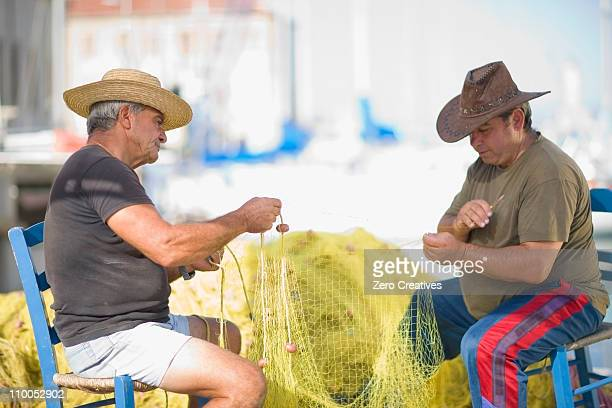 Men preparing fishing net