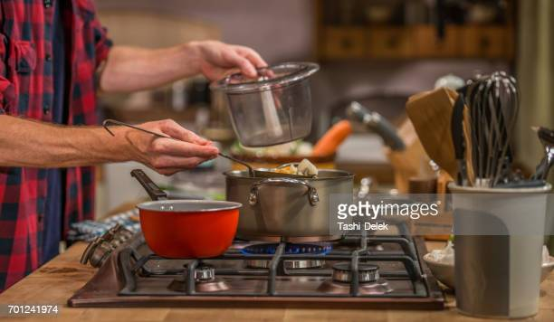 men preparing food - cooker stock pictures, royalty-free photos & images
