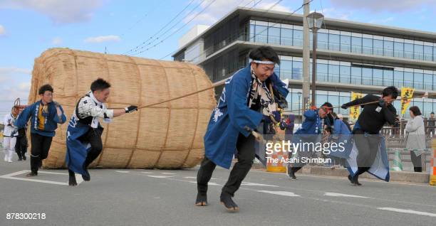 Men pull the 1ton rice bale during the bale rolling race as a part of the Tamana OTawara Festival on November 23 2017 in Tamana Kumamoto Japan
