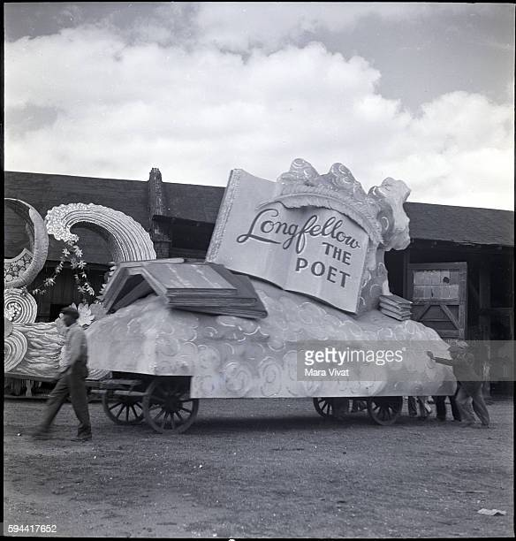Men push a Mardi Gras parade float dedicated to Longfellow out of a warehouse in New Orleans Louisiana circa 1950