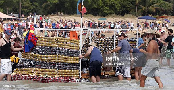 Men push a vessel made of beer cans as thousands flock to Darwin's Mindal beach during the annual Darwin Beer Can Regatta July 29 2007 in Darwin...