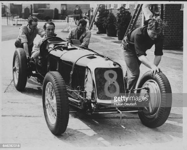 Men push BOAC boss Whitney Straight in his Maserati race car in 1934