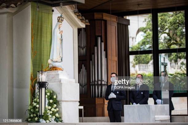Men put the figure of Our Lady of Fatima on the display of the chapel of the apparitions at the end of the procession Due to the COVID19 pandemic...