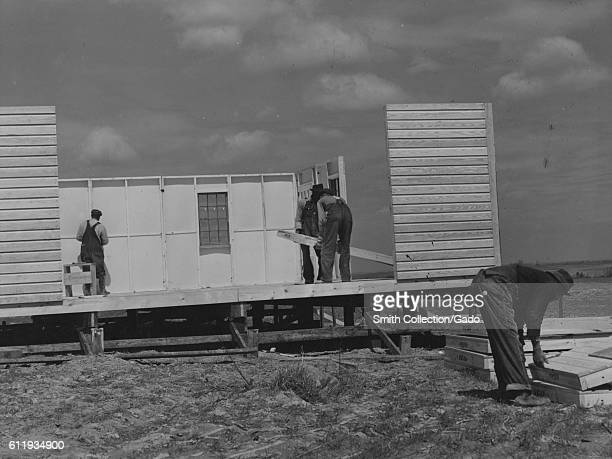 Men put the walls up on a house at the Farm Security Administration project in Pacolet South Carolina 1940