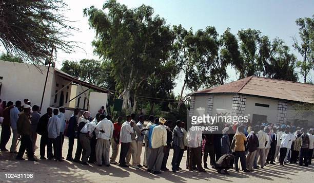 Men queue on June 26 2010 to vote at a poll satation in the selfproclaimed state of Somaliland that closed its borders Saturday as voters chose their...
