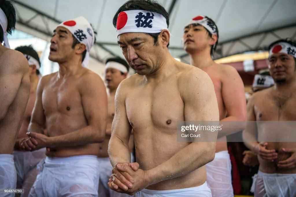 Men queue to reenter a pool as they take part in a purification ritual that involves pouring ice-cold water over themselves at Kanda Myojin shrine on January 13, 2018 in Tokyo, Japan. The coming of age purification ritual is a part of the two-day festival held annually at Kanda Myojin Shrine each January to honour and pay homage to Daikoku, the deity of fortune. Although primarily for 20 year-olds, the ceremony is now undertaken by people of all ages who pour ice-cold water over themselves in pool of water and ice blocks to purify themselves to traditional Japanese music.