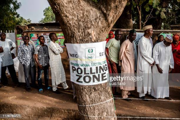 TOPSHOT Men queue to vote in the presidential election at Agiya polling station a few hours before polls opening in Yola Adamawa State Nigeria early...