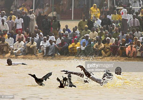 Men race each other towards wild ducks in a duck hunting competition during the Argungu Fishing Festival on March 19 in Argungu Nigeria The Argungu...