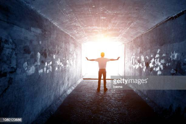 men reach the end of the tunnel - light at the end of the tunnel stock pictures, royalty-free photos & images