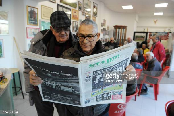 Men read Italian newspaper in a bar showing Italy soccer team defeat on its front pages the day after Italy failed to qualify for the World Cup 2018...