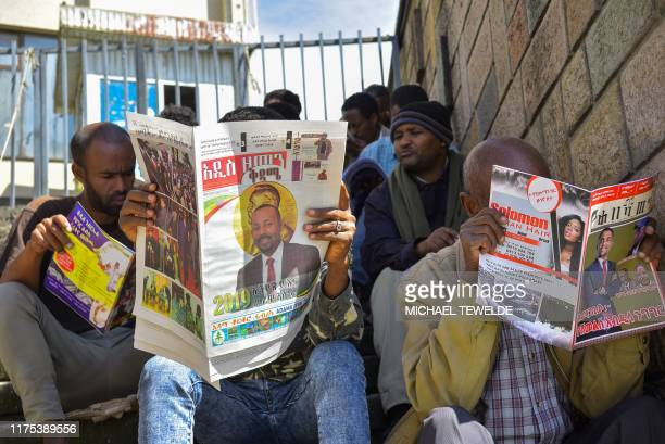 Men read the last edition of local newspapers in Addis Ababa on October 12 with the news of Ethiopian Prime Minister Abiy Ahmed's award of The Nobel...