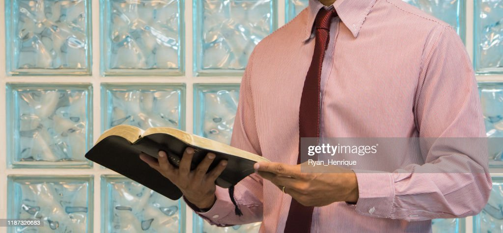 Men reading and holding the Holy Bible : Stock Photo