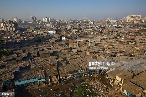Men recycle waste on rooftops in Dharavi slum on February 3, 2009 in Mumbai, India. The re-development of asia's largest slum, the Dharavi, spanning...