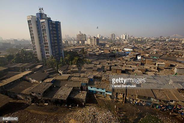 Men recycle waste on rooftops in Dharavi slum on February 3 2009 in Mumbai India The redevelopment of asia's largest slum the Dharavi spanning over...