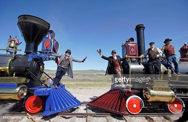 Men reenact the historic Champagne Toast with the Jupiter and the 119 steam engines make for the 150th anniversary of the driving of the Golden Spike...