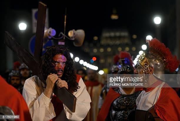 Men reenact the way of the cross by Jesus Christ on Via della Conciliazione leading from St.Peter's Basilica at the Vaticano in Rome on February 26,...