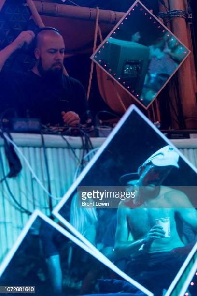 Men reflected in a mirror dance during Wonderfruit 2018 on December 13 2018 in Pattaya Thailand