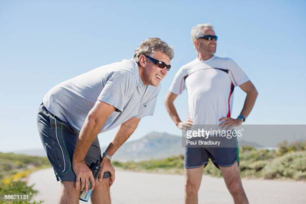 Men relaxing after jogging
