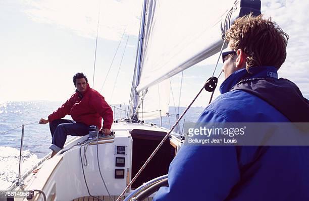 Men relaxing on sailboat